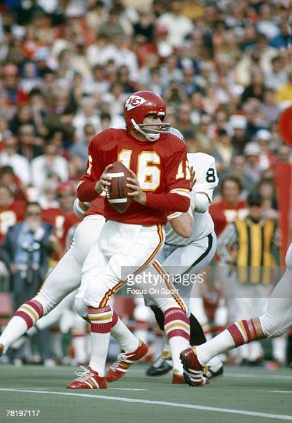 CITY MO CIRCA 1970's Quarterback Len Dawson of the Kansas City Chiefs drops back to pass against the Oakland Raiders during an early circa 1970's NFL...