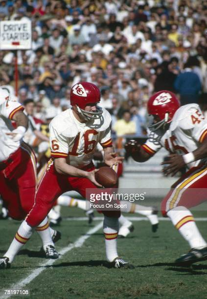 CIRCA 1970's Quarterback Len Dawson of the Kansas City Chiefs turns to hand the ball off during a early circa 1970's NFL football game Dawson played...