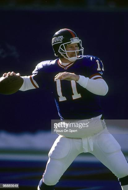 RUTHERFORD NJ CIRCA 1980's Quarterback Phil Simms of the New York Giants drops back to pass during a circa 1980's NFL football game at Giant Stadium...