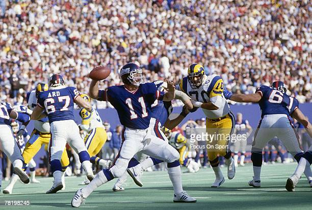 RUTHERFORD NJ CIRCA 1980's Quarterback Phil Simms of the New York Giants drops back to pass against the Los Angeles Rams during a circa 1980's NFL...