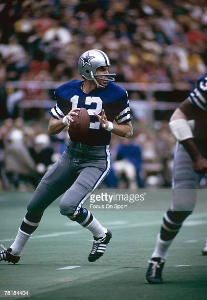 ST LOUIS MO CIRCA 1970's Quarterback Roger Staubach of Dallas Cowboys drops back to pass against the St Louis Cardinals during a mid circa 1970's NFL...