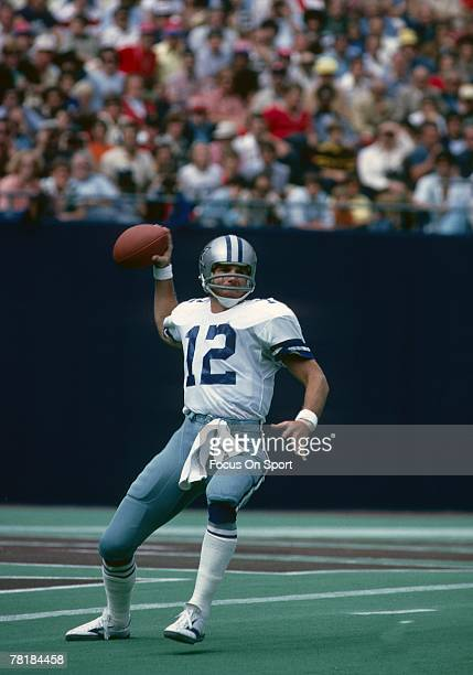 RUTHERFORD NJ CIRCA 1970's Quarterback Roger Staubach of Dallas Cowboys drops back to pass against the New York Giants during a mid circa 1970's NFL...