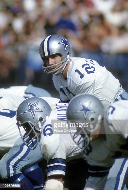CIRCA 1970's Quarterback Roger Staubach of Dallas Cowboys is under center during a mid circa 1970's NFL football game Staubach played for the Cowboys...