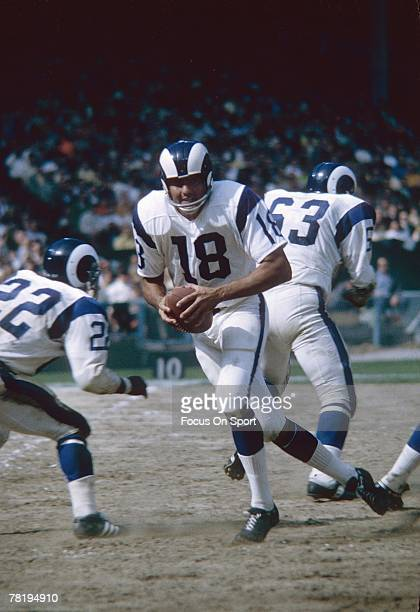 BRONX NY CIRCA 1960's Quarterback Roman Gabriel of the Los Angeles Rams drops back to pass against the New York Giants during a mid circa 1960's NFL...