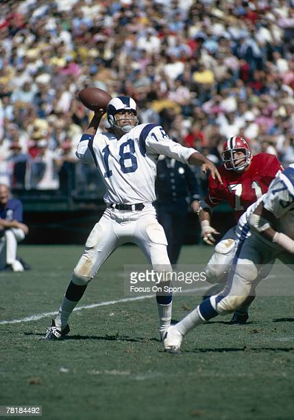 S: Quarterback Roman Gabriel of the Los Angeles rams is back to pass against the Atlanta Falcons in a mid circa 1960's NFL football game. Gabriel...