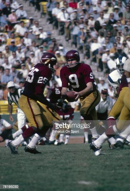 C CIRCA 1960's Quarterback Sunny Jurgenson of the Washington Redskins turns to hand the ball off against the Los Angeles Rams during a late circa...