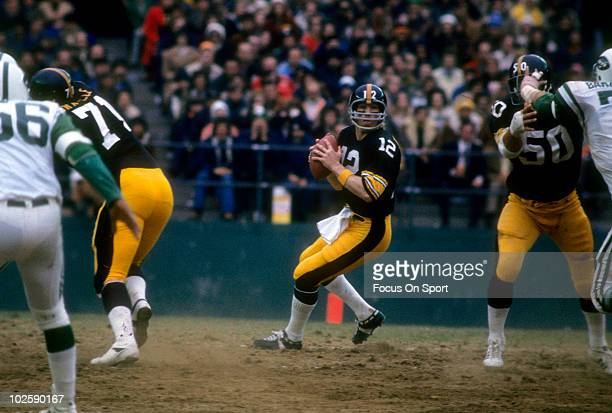 FLUSHING NY CIRCA 1970's Quarterback Terry Bradshaw of the Pittsburgh Steelers drops back to pass against the New York Jets circa mid 1970's during...