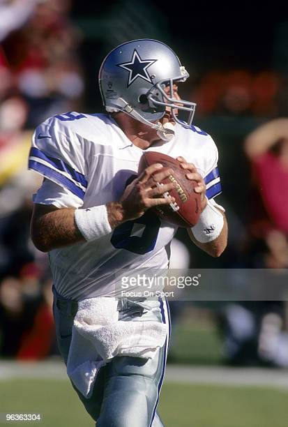 CIRCA 1990's Quarterback Troy Aikam of the Dallas Cowboys drops back to pass during a mid circa 1990's NFL football game Aikman played for the...