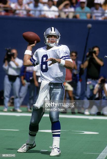RUTHERFORD NJ CIRCA 1990's Quarterback Troy Aikam of the Dallas Cowboys set to throw a pass against the New York Giants during a mid circa 1990's NFL...