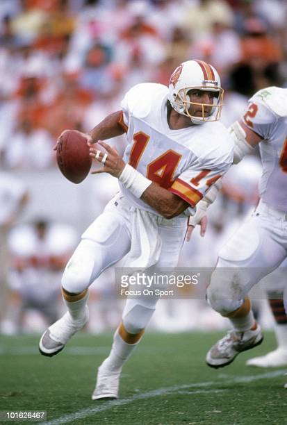 TAMPA FL CIRCA 1980's Quarterback Vinny Testaverde of the Tampa Bay Buccaneers in action scrambles with the ball circa late 1980 during an NFL...