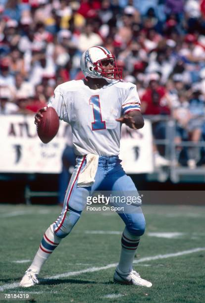 ATLANTA GA CIRCA 1980's Quarterback Warren Moon of the Houston Oilers drops back to pass against the Atlanta Falcons during a mid circa 1980's NFL...
