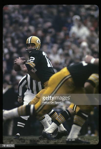 BAY WI CIRCA 1960's Quarterback Zeke Bratkowski of the Green Bay Packers drops back to pass during a mid circa 1960's NFL football game at Lambeau...