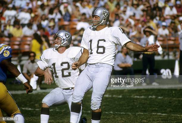 SAN DIEGO CA CIRCA 1970's Quarterback/Kicker George Blanda of the Oakland Raiders attempts a field goal with quarterback Ken Stabler holding for him...