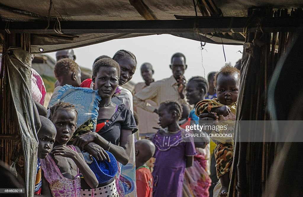 IDP's (Internally displaced persons) queue to register at the UNMISS Protection of Civilian (POC) site in Bentiu, Unity State, on February 27, 2015. The camp receives up to 200 new IDP each day, due to lack of services in the town. The World Health Organization today appealed for 1.0 billion USD in additional funds to help provide life-saving health services to millions in need in conflict-ravaged Syria, Iraq, Central African Republic and South Sudan. For South Sudan, which has been wracked by fighting since an alleged attempted coup in December 2013, 90 million USD is needed to provide vital health services to some 3.35 million people, WHO said.
