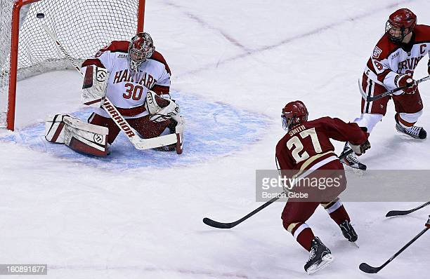 S Quinn Smith scores the first goal of the game, first period, as he beats Harvard goalie Raphael Girard in the first period. Harvard University met...
