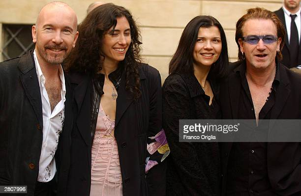 U2's quitarist The Edge and Irish Singer Bono with his wife Alison Stewart pose as they leave the Teatro Comunale at the end of the wedding of...