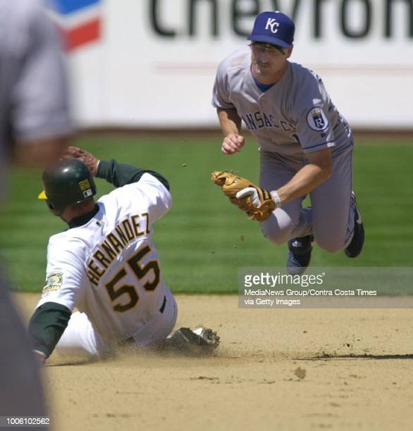 A's Ramon Hernandez is out at 2nd on Terrance Long's bunt in the 7th inning as the Royals Jeff Reboulet flies out of the way as Oakland ended a...