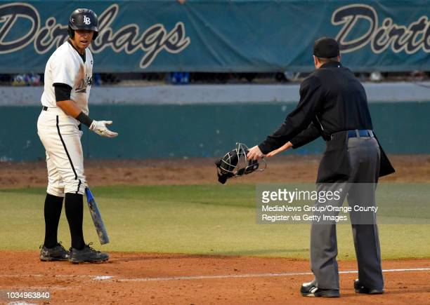 LBSU's Ramsey Romano questions a called third strike with home plate umpire Carl Coles in Long Beach on Thursday April 13 2017 LBSU vs CSU...