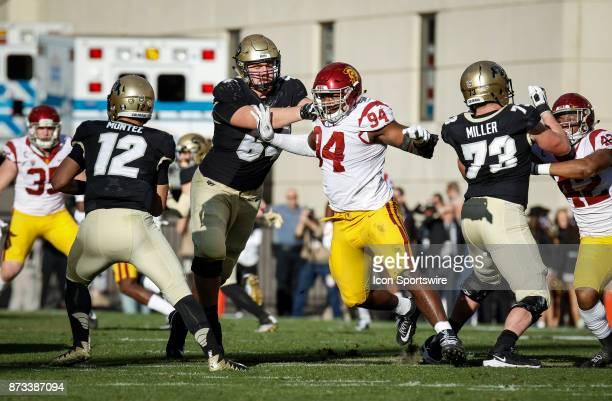 USC's Rasheem Green chases Colorado quarterback Steven Montez during the Colorado Buffalos game versus the USC Trojans on November 11 at Folsom Field...