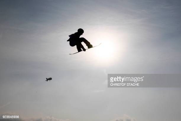 TOPSHOT USA's Redmond Gerard takes off in a warm up jump during the final of the men's snowboard big air event at the Alpensia Ski Jumping Centre...