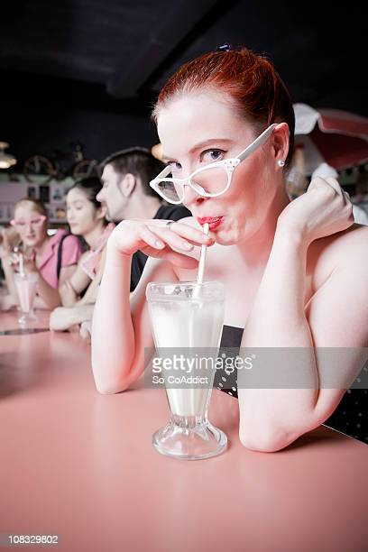 1950's Retro Girl Sipping Milkshake