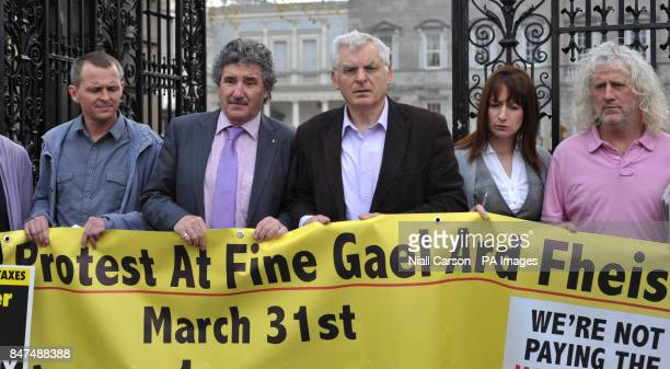TD's Richard Boyd Barrett John Halligan Joe Higgins Clare Daley and Mick Wallace show their support for the boycott of the household tax during a...
