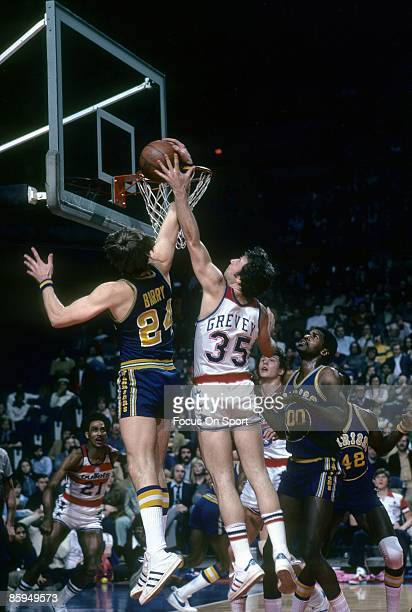 BALTIMORE MD CIRCA 1970's Rick Barry of the Golden State Warriors battle for a rebound with Kevin Grevey of the Washington Bullets during a mid circa...