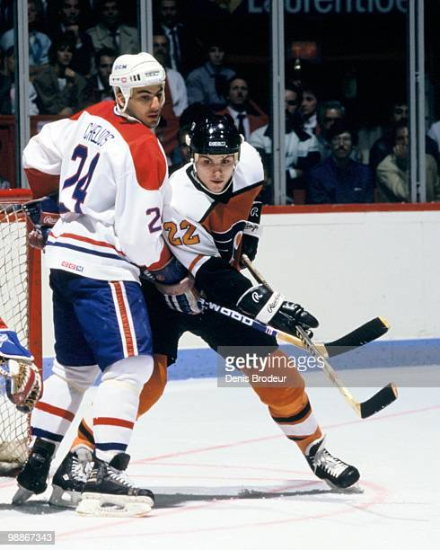 MONTREAL 1980's Rick Tocchet of the Philadelphia Flyers skates against Chris Chelios of the Montreal Canadiens during the 1980's at the Montreal...