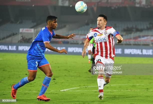 ATK's Robert Keane vies with FC Goa's Narayan Das during the Indian Super League football match between ATK and FC Goa at the Vivekananda Yuba...