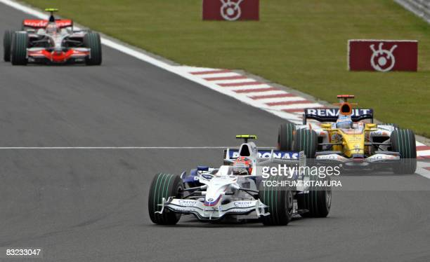 S Robert Kubica of Poland leads Renault's Fernando Alonso of Spain and McLaren's Heikki Kovalainen of Finland at the first lap of Formula One's...
