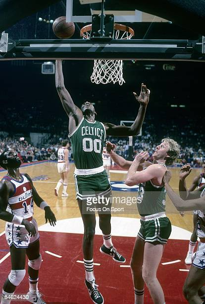 BALTIMORE MD CIRCA 1980's Robert Parish of the Boston Celtics goes up to grab a rebound in front of teammate Larry Bird and Ricky Sobers of the...
