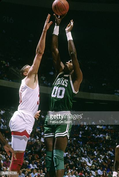 RUTHERFORD NJ CIRCA 1990's Robert Parish of the Boston Celtics shoot over Sam Bowie of the New Jersey Nets during a early circa 1990's NBA basketball...