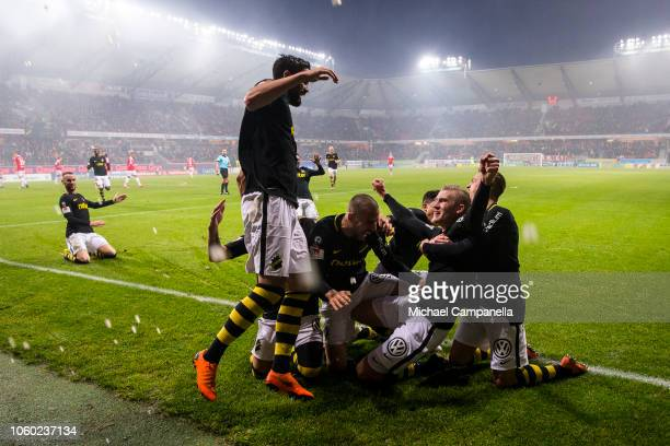 AIK's Robin Jansson scores the 10 goal securing a first place finish in Allsvenskan and celebrates with teammates during an Allsvenskan match between...