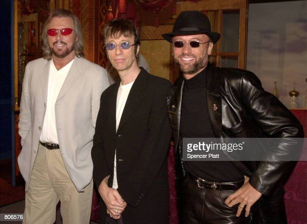 70's rock/disco group The Bee Gees pose for the photographer at a press conference April 23 2001 in New York prior to announcing the release of their...