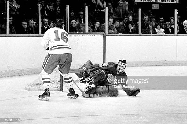 MONTREAL CANADA CIRCA 1970's Rogatien Vachon of the Los Angeles Kings blocks a shot from Henri Richard of the Montreal Canadiens during a game at the...