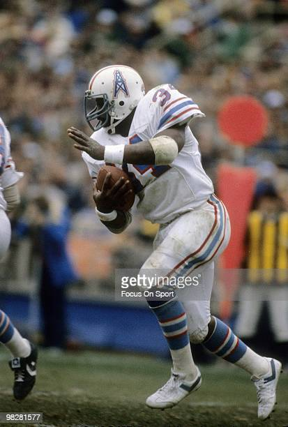CIRCA 1980's Running Back Earl Cambell of the Houston Oilers plays carries the ball during an early circa 1980's NFL football game Cambell played for...