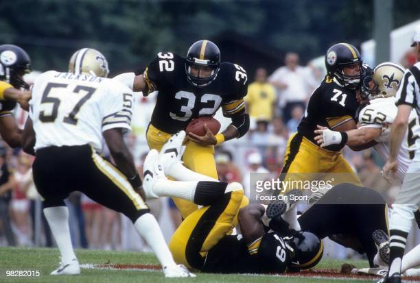 CIRCA 1980's Running back Franco Harris of the Pittsburgh Steelers plays carries the ball against the New Orleans Saints circa 1980's during an NFL...