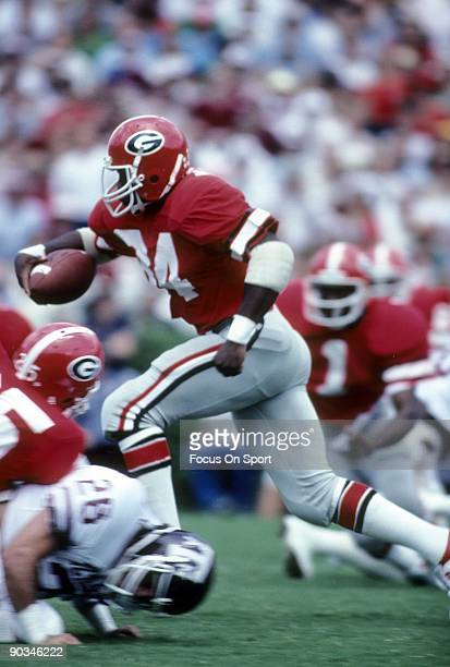 S: Running back Herschel Walker of the Universiy of Georgia Bull Dogs carries the ball against Texas A&M during an early circa 1980's NCAA football...