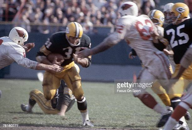 BAY WI CIRCA 1960's Running back Jim Taylor of the Green Bay Packers carries the ball against the St Louis Cardinals during a circa 1960's NFL...