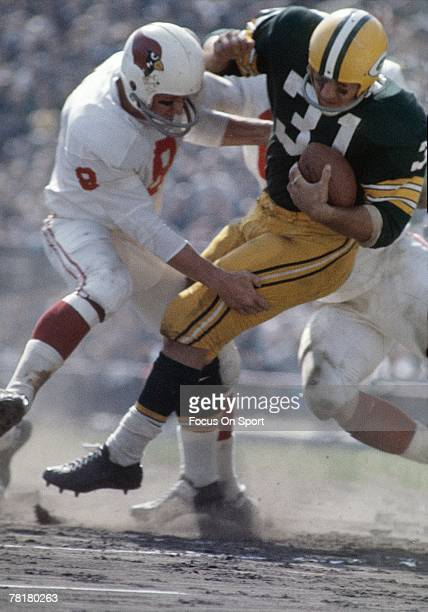 BAY WI CIRCA 1960's Running back Jim Taylor of the Green Bay Packers is tackled by a St Louis Cardinals defender during a circa 1960's NFL football...