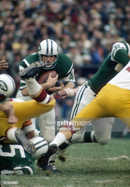 FLUSHING NY CIRCA 1970's Running back John Riggins of the New York Jets carries the ball against the San Diego Chargers during a circa 1970's NFL...