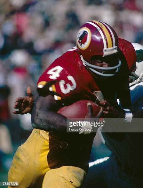 WASHINGTON DC CIRCA 1970's Running back Larry Brown of the Washington Redskins carries the ball against the Philadelphia Eagles during a circa 1970's...