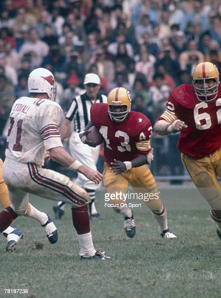 WASHINGTON DC CIRCA 1970's Running back Larry Brown of the Washington Redskins carries the ball against the St Louis Cardinals during a circa 1970's...