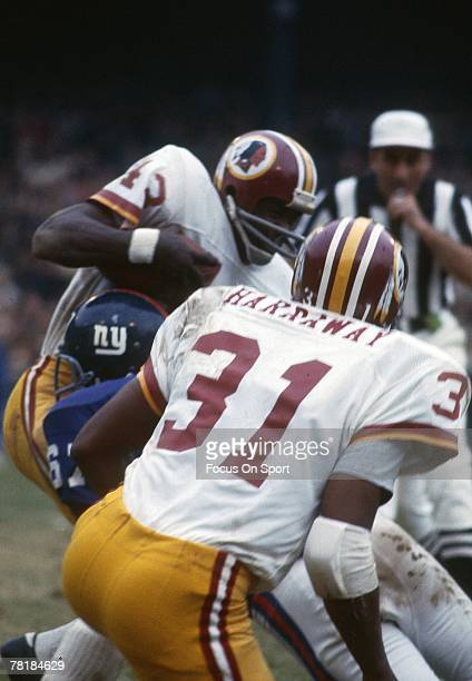 BRONX NR CIRCA 1970's Running back Larry Brown of the Washington Redskins is brought down by a New York Giants defender during a early circa 1970's...