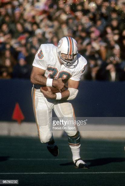 FOXBORO MA CIRCA 1970's Running back Larry Csonka of the Miami Dolphins carries the ball against the New England Patriots circa mid 1970's during an...