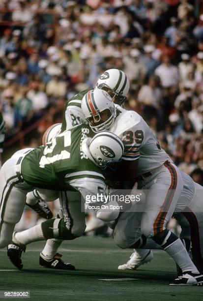 MIAMI FL CIRCA 1970's Running back Larry Csonka of the Miami Dolphins in action carries the ball hit by linebackers Ralph Baker of the New York Jets...