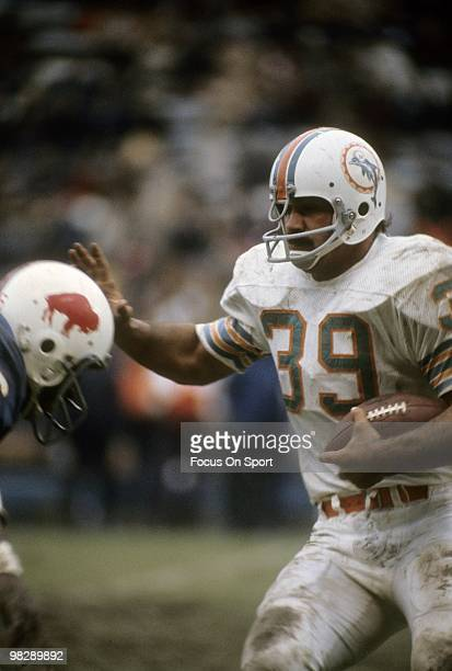 BUFFALO NY CIRCA 1970's Running back Larry Csonka of the Miami Dolphins in action carries the ball against the Buffalo Bills circa early 1970's...