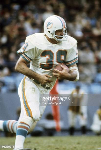 CIRCA 1970's Running back Larry Csonka of the Miami Dolphins in action carries the ball circa mid 1970's during an NFL football game Csonka played...