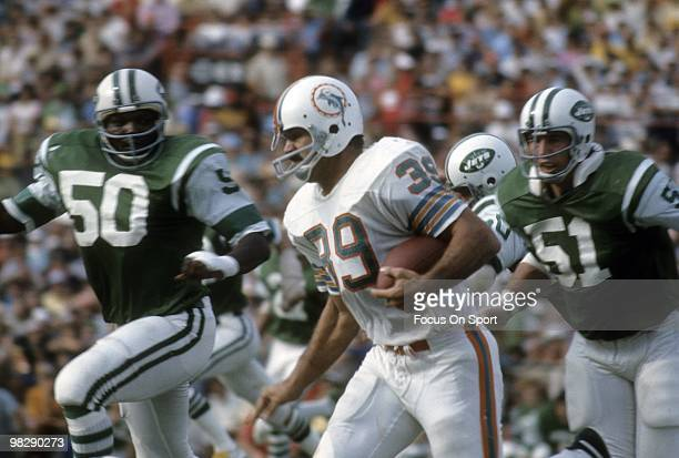MIAMI FL CIRCA 1970's Running back Larry Csonka of the Miami Dolphins in action carries the ball chased by linebackers Ralph Baker and Michael Taylor...