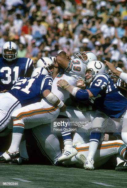 MIAMI FL CIRCA 1970's Running back Larry Csonka of the Miami Dolphins in action is hit by linebacker Mike Curtis and defensive back Rick Volk of the...
